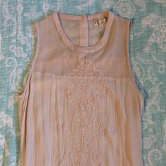 Beaded and Embroidered Tank Very pretty bead and embroidered work with cute button detail on back. Pinkish cream color. Tops Tank Tops
