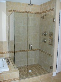 get rid of the white shower floor and match tile instead