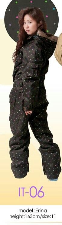 Erina in a black belted with tea  green & pink tiny polka dots on her onesie.