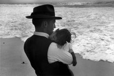 A father and his son fallen asleep in his arms at the seaside near Nazare, Portugal, Photographed by Édouard Boubat. Robert Doisneau, Moma, Anne Sexton Poems, Ex Yougoslavie, New York City, Louis Aragon, Fotografia Social, Blog Art, Become A Photographer