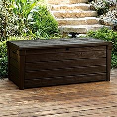 Blending style and functionality, the Brightwood 120 Gallon Resin Deck Box by Keter is an excellent addition to your outdoor living area. This deck box pro Plastic Garden Storage Box, Plastic Sheds, Storage Boxes, Storage Ideas, Storage Solutions, Storage Systems, Seat Storage, Storage Organization, Patio Storage Bench