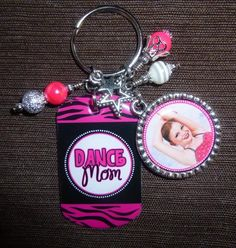 This personalized photo key chain would make a fabulous gift for any dance mom! The photo is attached to a metal dog tag and the name is inside a bezel pendant. Both are covered with an epoxy dome. The key chain includes the beads and charms. Cheer Coach Gifts, Dance Teacher Gifts, Gifts For Sports Fans, Cheer Mom, Perfect Christmas Gifts, Christmas Tree, Dance Moms, Other Accessories, Gifts For Mom
