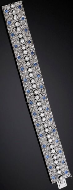 Full view: Art Deco diamond and sapphire bracelet with 18.00 carats of sparkling white diamonds and 8.00 carats of azure blue sapphires, all set in platinum. Via Diamonds in the Library.