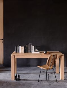 Slice is a dining table with a unique character, but we added a little extra. This table can easily be extended without interruption of the wood grain pattern. Made from solid oak, this dining table is available in three sizes. Also available in teak and walnut.