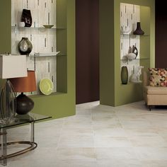 This photo features Pietre Bianca 18 x 18 on the floor in a diamond pattern. Wall features Pietre Bianca 12 x 20 Interlocking accent with Bijou de Verre glass mosaic strips in Cream Soda.