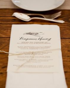 This menu card was inspired by the couple's favorite restaurantand doubled as a place card. A custom rubber stamp of the venue's barn finished each one off.