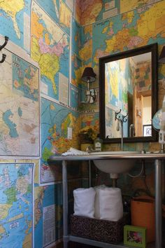 Cover the walls in maps. For a quick and inexpensive change of pace, why not paper your bathroom walls in old maps? Simply layer them on the...
