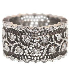 """Buccellati Diamond White Gold Ring. Hand made by the Italian jewelry firm Buccellati, this ring features the famous """"Tulle"""" hand pierced pattern accented by white diamonds. Italy. Modern"""