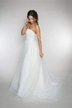 {Pippa Pearl} This tulle ball gown wedding dress has 6 layers of soft netting with a full beaded pearl bodice. The back is detailed with strands of pearls and a chapel length train. | Bride | Wedding | Wedding