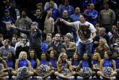 'This community's team' needs a Tigers coach who can handle that reality.  University of Memphis fans during a February game last season against SMU.