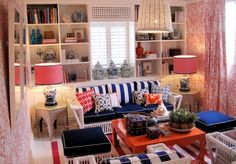 darling preppy room, striped living room, striped couch, built in book shelves