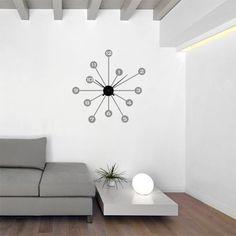 Original reloj de pared de vinilo en forma de radios, con mecanismo de aluminio incluido.