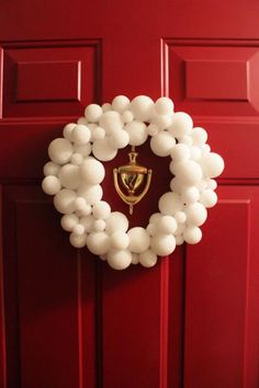 Make a cute inexpensive snowball wreath for the holidays!