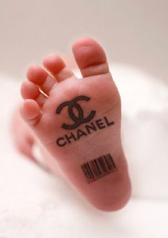 """Some people are just born with """"It"""" ;) Chanel symbol tattoo & barcode bottom of babies foot"""