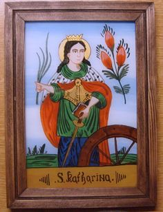 podmalba - svatá Kateřina Alexandrijská Obrázek ze svatého kouta - malováno dle lidové podmalby z 19.stl. na zadní stranu skla. Zobrazena je svatá Kateřina, pocházela z vysoce urozeného rodu a již v útlém mládí dosáhla vynikajícího vzdělání. Byla prý tak neobyčejně výřečná, že když debatovala s padesáti pohanskými filozofy, rozbila jejich argumenty svými ...