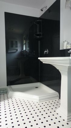 Black colored smooth solid surface shower wall panels in a corner shower - Innovate Building Solutions Budget Bathroom, Bathroom Wall Decor, White Bathroom, Small Bathroom, Bathroom Remodeling, Bathroom Ideas, Remodeling Ideas, Master Bathroom, Bathroom Interior