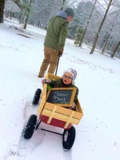 Ian enjoying his first snow while riding in his wagon.