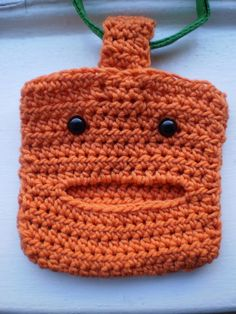 crocheted bag holder for dog leash - would be easy to make something like this to carry rolls of clean up bags