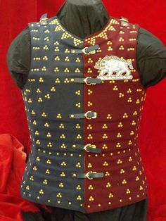 With the announcement of the remains of Richard the III being found i decided to make a liveried brigandine. Weyden brigandine. This one in murray and azure wool with spring steel plates, hand tinned with decorative brass rivets and historical cast buckles. The badges are just tacked in place and are easily removable for different households.