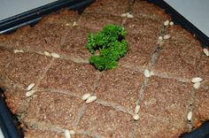 Baked Kibbee - traditional Lebanese dish. Especially delicious with plain yogurt lumped on top!