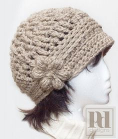 Would love to try to make this hat, too...  (Note to self: also check out the pattern for the 'easy ponytail hat with button band.')