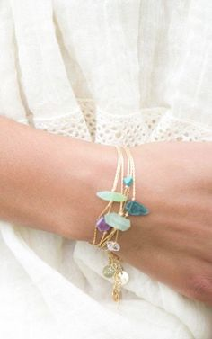 Layered delicate bracelets. Want! No, need, right now!