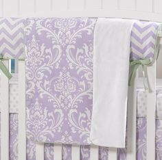 Lavender Damask Receiving Blanket | Liz and Roo Fine Baby Bedding. We love this pretty lilac color for a baby girl's nursery! The elegant print paired with a chevron rail cover and crib skirt adds a modern and adorable finish to the crib set.