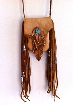 Finished with deerskin fringe, Ethiopian metal trade beads, and handcut and burned leather. Beaded Purses, Beaded Bags, Leather Pouch, Leather Purses, Leather Bags, Art Du Cuir, Native American Medicine Bag, Fringe Bags, Boho Bags