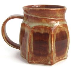 Jordan creatively made and trimmed this mug on the potters wheel, then Tiffany adds the handle and glazed the piece after bisque firing.