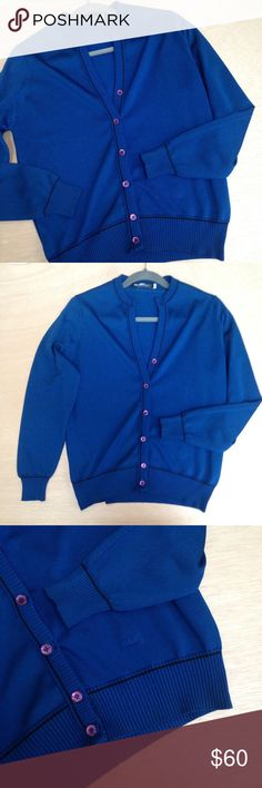 """vintage Givenchy Sport cardigan sweater Vintage 1970s Givenchy Sport button up cardigan sweater. In excellent vintage condition - only flaw is near 2nd button.  Material: cotton blend. Color: navy blue.  Measurements are taken lying flat.  Size 38; best fits modern S. Armpit to armpit: 19"""".  Length (shoulder to hemline): 24"""". Vintage Sweaters Cardigans"""