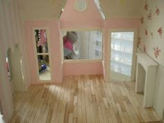 Pinner Said: I made the floor with pine Popsicle sticks.