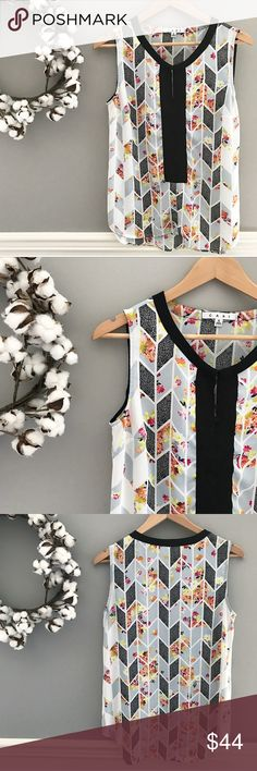 """▫️CAbi Floral Geometric Sleeveless Grosgrain Top This is arguably one of CAbi's most sought after tops. If you search for it on Pinterest, you'll find a thousand outfit ideas! Beautiful floral pattern fills alternating blue-ish grey geometric shapes. A luscious grosgrain ribbon lines the front (hook and eye closure at the neckline). Size Small but I think it leans more towards a medium depending on how flowing you want it to be. 38"""" bust, 27"""" length in the front, 29"""" in the back. CAbi Tops…"""