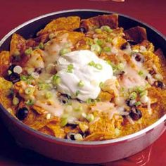 Some like it hot; others like it even hotter. Mild enchilada sauce gives this skillet dish plenty of spiciness. If you're after extra spicy foods, use hot enchilada sauce or Monterey Jack cheese with jalapeno peppers.