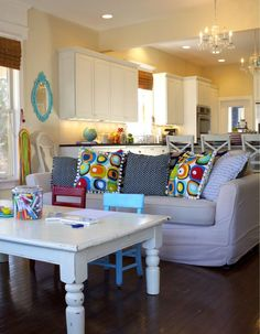 love the turquoise mirror i made one just like it and the colorful pillows and isnt that white coffee table awesome!