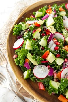 Kale Salad with Radish, Cucumber, Avocado, Red Bell Pepper, and Pomeganates