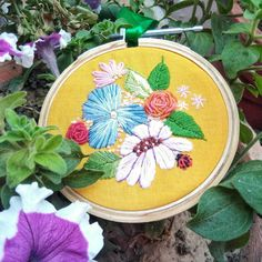 Excited to share the latest addition to my #etsyshop: Floral embroidery hoop, bright flower wall art, hand embroidery floral designs, plant lovers gift, gift for florist, colourful wall art https://etsy.me/2Jm82iA #art #fibreart #yellow #birthday #mothersday #ladybug