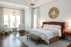 The master bedroom features the same calming paint color we've seen before in this house; Sherwin Williams Sea Salt.