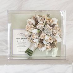 Roses and white calla lilies are freeze-dried and framed in a museum grade frameless shadowbox.  Nature's Beauty Flower Preservation  1-800-682-3580 Instagram: @naturesbeauty_freezedry