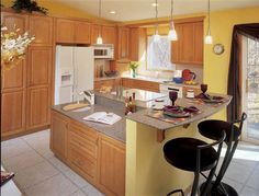 I like yellow, but don't care for this combo with honey oak cabinets.