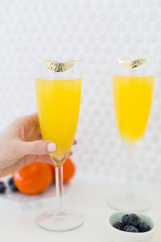 Add a little edible gold paint made to look like lipstick marks to a pair of champagne flutes. It makes for gorgeous presentation but can easily be washed off!