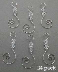 Pack of 24 silver wire diamond beaded ornament hooks. 2 inches long. Good quality. Use year round for photo ornaments. Photo Jewelry