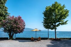 View of the Garda lake from Villa Feltrinelli with an intimate table and chairs. #lake #garda #grandhotel #villafeltrinelli #garden #relax