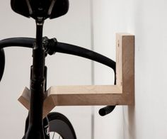 """Creative DIY bike storage racks to solve the """"how to store bikes"""" question! These DIY bike racks are inexpensive to make and are simple projects! Indoor Bike Rack, Diy Bike Rack, Bike Hanger, Bike Storage Rack, Bicycle Rack, Bicycle Tools, Bicycle Wheel, Wall Mount Bike Rack, Bike Mount"""