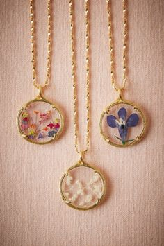 Whimsical flower necklaces.