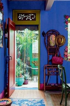 Don't shy away from an over-the-top colored wall—when paired with other bold colors and patterns it looks like a scene from a bright Mexican bazaar.