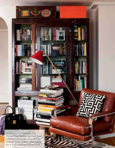 An extensive collection of books accented by vintage finds, from 'The Things That Matter'.  http://www.lonnymag.com/issues/43-lonny-october-2012/pages/1#p21