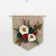 Just Listed! My first Christmas banner for 2016 is up in the shop. Look for a couple other styles coming soon! . . . . . #felt #flowers #feltflowers #succulents #feltsucculents #details #banner #wallhanging #handmade #makersgonnamake #girlboss #bossbabe #makersvillage #craftsposure #shophandmade #handmadeisbetter #etsyfinds #etsy #etsyshop #feltfascination #benziefelt #doitfortheprocess #creativelifehappylife #havencharlotte #christmas #christmasdecor #christmasdecorations