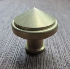 "The Pisa decorative cabinet knob for either cabinet doors or drawers is supplied with a machine screw for through-bolting. It measures 1-1/4"" in diameter.  Also available in 1 1/2"", 1"", and 3/4""   Finishes available: Polished brass, Polished Bronze, Oxidized brass/bronze, Polished stainless steel, Satin stainless steel."