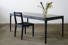 http://jamesmudge.com/files/gimgs/1_brass-top-tapered-leg--dark-charcoal-with-chair.jpg