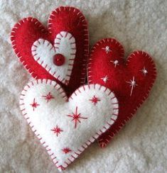 Heart Felt Ornaments. (I love the white one with the red snowflakes. The tutorial is great!)